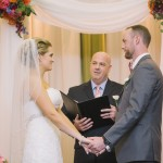 Officant, bride and groom at the Omni Hotel Austin