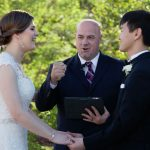 Officiant and couple at wedding