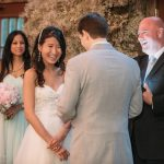 Happy couple and wedding officiant I Do Ceremonies