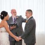 Austin officiant with bride and groom at altar