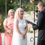 Bride laughing during ceremony with groom and Austin officiant