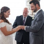Austin wedding officiant wedding at The Lookout with bride and groom exchanging rings