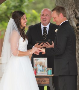 Bride and groom exchanging rings with Austin Wedding Officiant Stephen Simmons