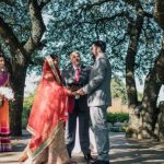 Bride groom and officiant at Antebellum Oaks