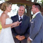 Austin officiant with bride and groom reading vows
