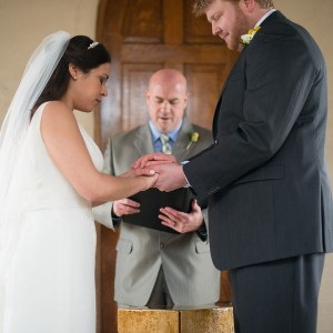 Austin wedding officiant prays for couple at chapel dulcinea