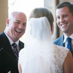 Austin officiant and groom smiling at bride
