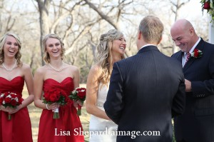 Wedding officiant reading vows at chateau on the creek Round Rock