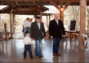 Austin Wedding officiant groom and ring bearer walking in