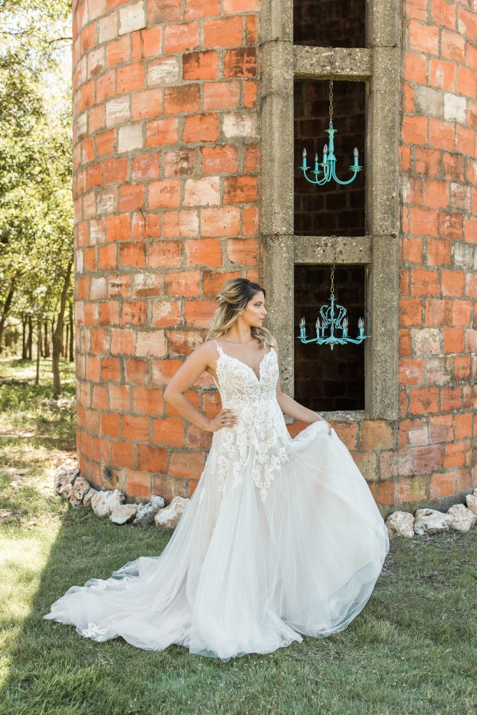 Bride in front of clay block silo temple texas